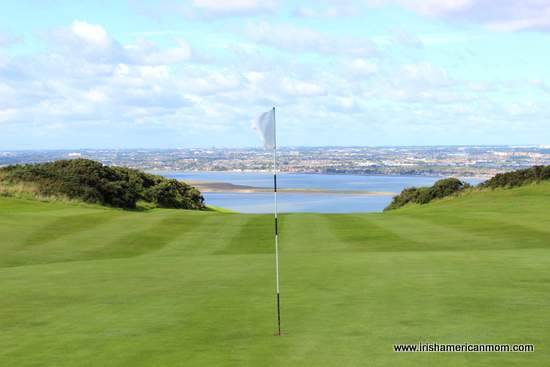 A flag in a golf hole on Howth golf course