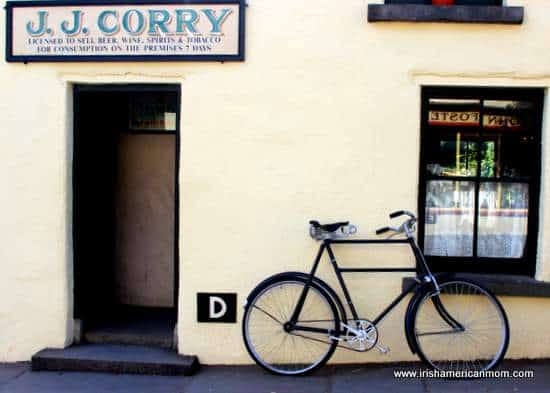 A bicycle standing outside a rural Irish shop