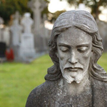 Head of Jesus on a stone statue in a cemetery