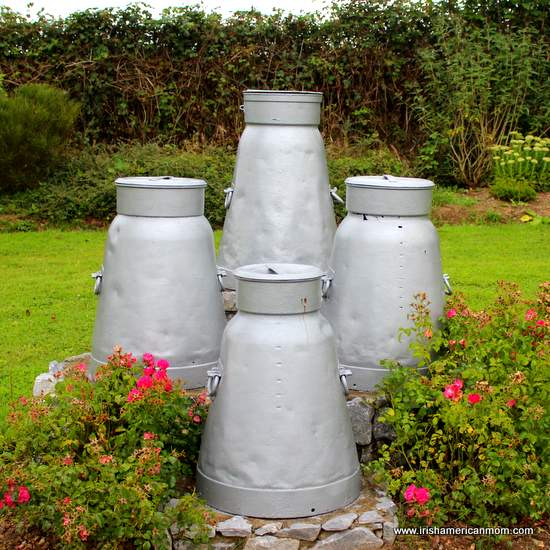 Four milk churns by the roadside in County Cork