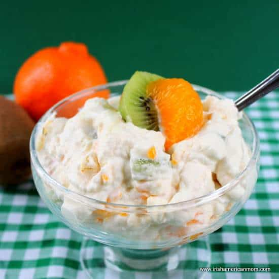 Meringue and cream mess mixed with orange and green fruits
