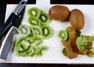 Slicing kiwis on a chopping board
