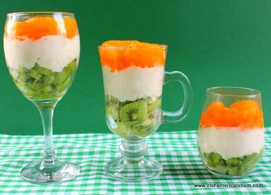 Three Irish flag fruit and cream parfait desserts standing in a row