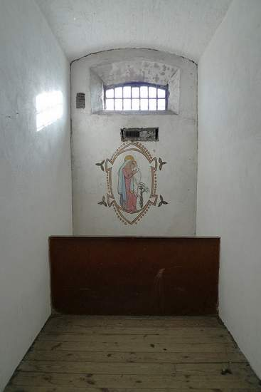 Grace Gifford's Prison Cell in Kilmainham Gaol with the mural she painted