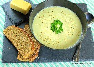 A serving of Irish potato soup in a black bowl
