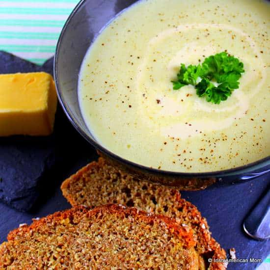 A bowl of Irish potato soup with brown bread