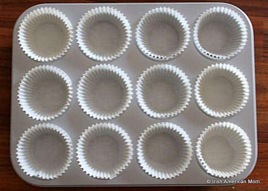 Linng a muffin tray with baking cases