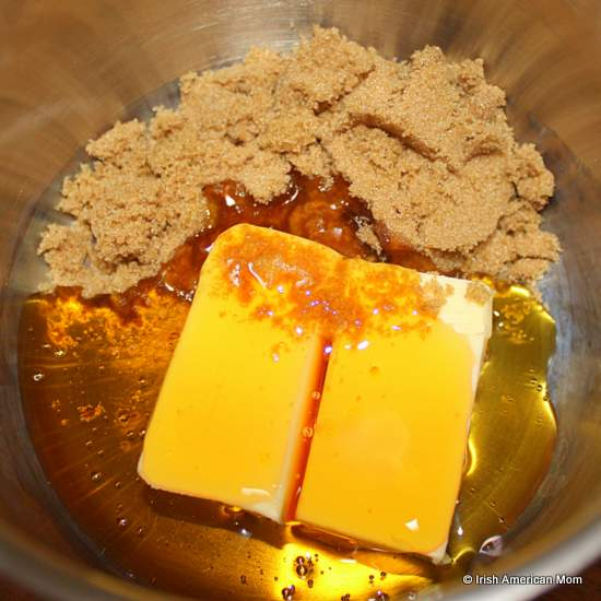 Melting butter with brown sugar and golden syrup for Irish flapjacks