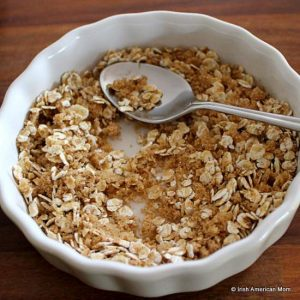 mixing oatmeal and brown sugar to sprinkle on top of muffins