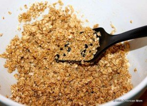 Mixing oats with golden syrup and melted butter to make flapjacks