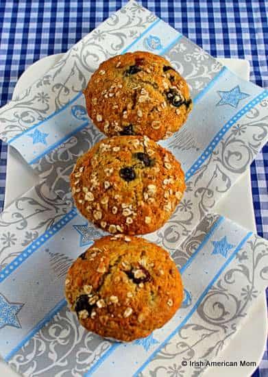 Three blueberry banana oatmeal muffins