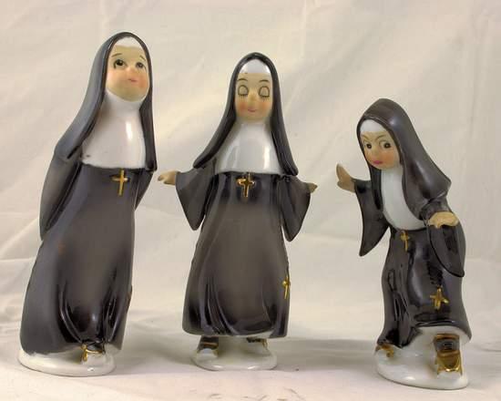 Three nuns in a row - cute statues of nuns