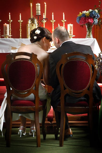 A quiet word between the bride and groom on their Irish wedding day.