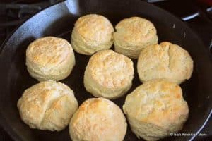 A cast iron pan with freshly baked scones or biscuits