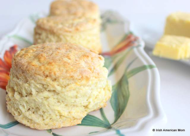 Three Irish buttermilk scones on a floral decorative plate