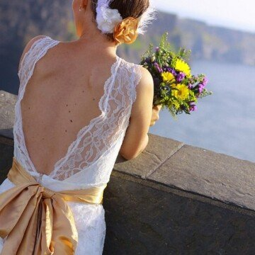 A bride looking at the Cliffs of Moher
