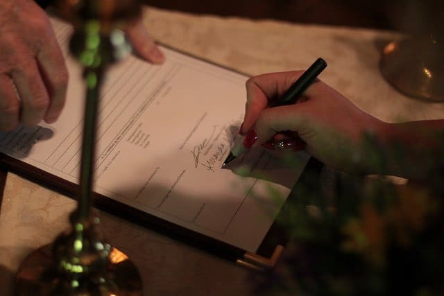 Signing the register after an Irish wedding