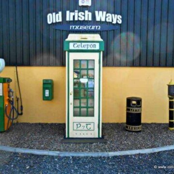 Old telephone booth with text sign above it