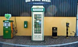 An old Irish telephone box beside a water pump and BP petrol pump