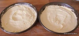 Batter for a sponge cake divided between two pans