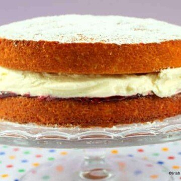 Victoria sponge sandwich on a cake stand