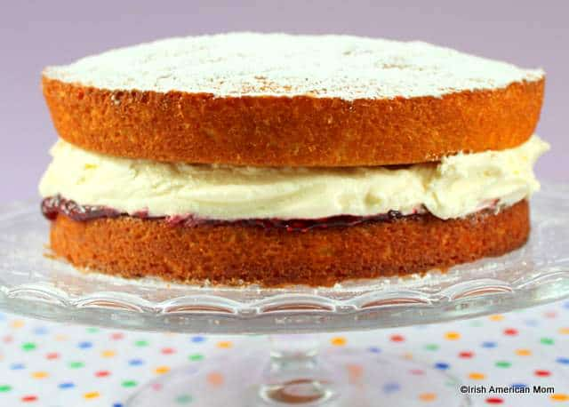 Victoria sponge sandwich on a cake stand