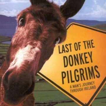 Donkey beside a road sign with text