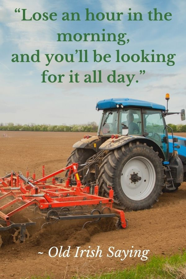 A tractor pulling a plow in a tilled field in a quotation graphic