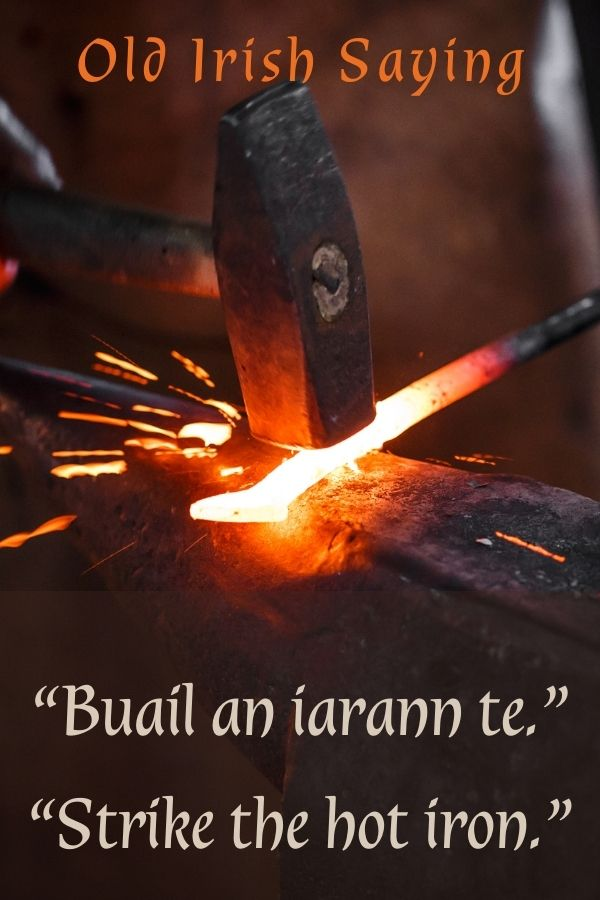 Strike while the iron is hot graphic featuring a blacksmith striking a hot piece of metal