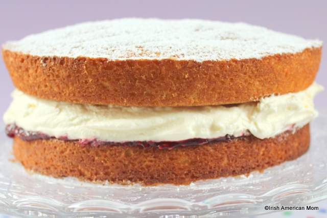 A victoria sponge sandwich with jam and heavy whipping cream