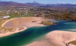 sandy beach with sea water inlet in County Donegal