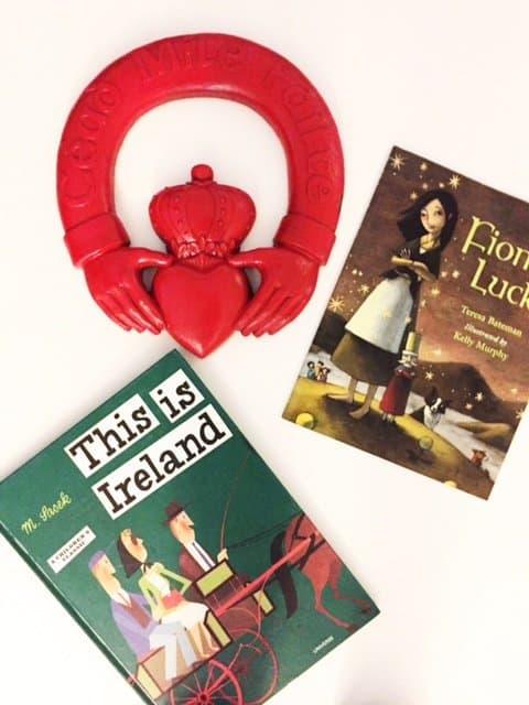 Claddagh door knocker beside two Irish books for children