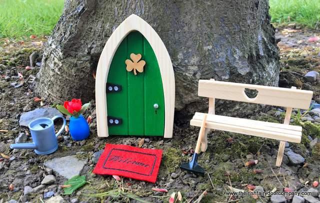 Fairy furniture beside a green Irish fairy door