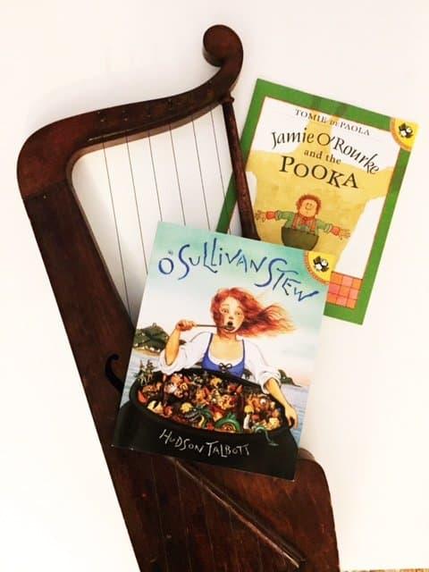 Magical Irish themed children\'s books beside a harp