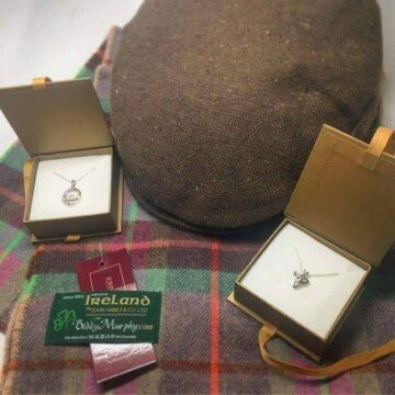Tweed hat, plaid scarf and pendants in boxes