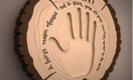 Child's hand print on a magical worry plaque