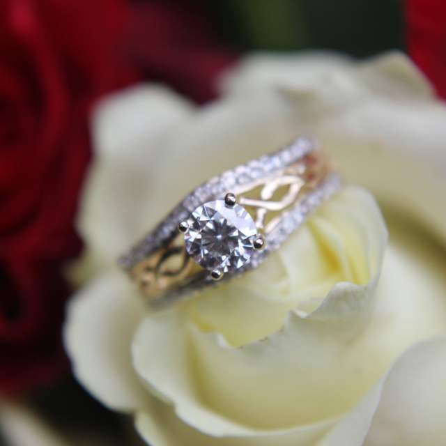 Celtic knot engagement ring with gold band and diamond