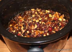 Dried fruit and liquids in a crockpot for mince pie filling