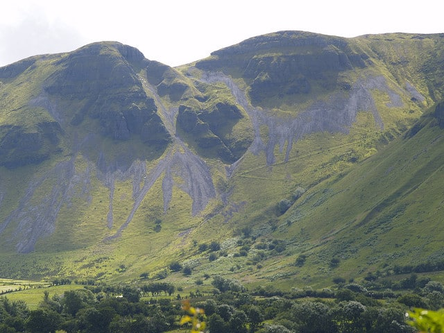 A large mountain with shale cliffs