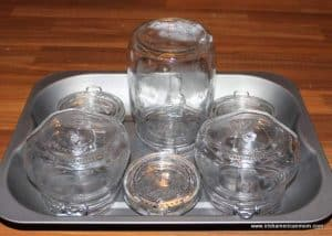 Serilizing jars in the oven by placing them on a metal baking pan