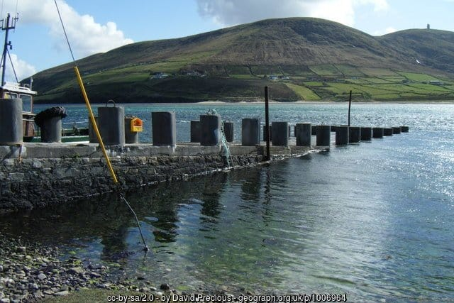 A boat pier near a mountain in Ireland