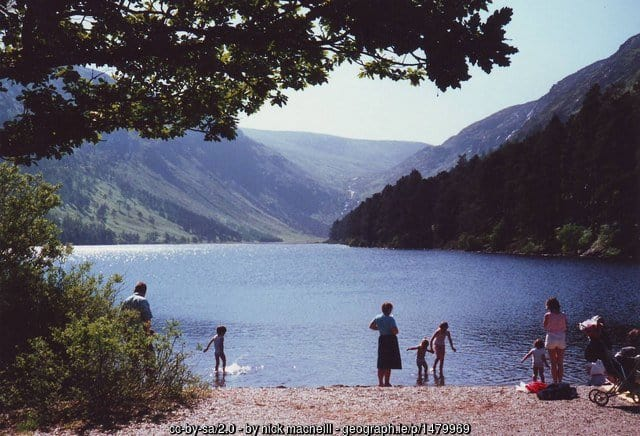 Family standing by the shore of a lake