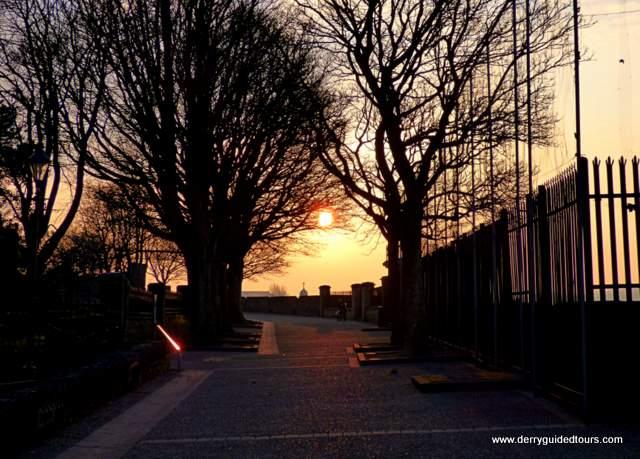 A sunset over a city street