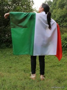Girl wearing an Irish flag cape