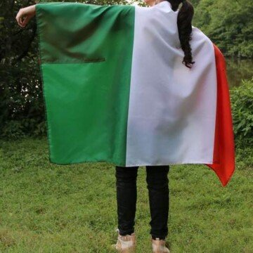 Girl wearing an Irish flag cape