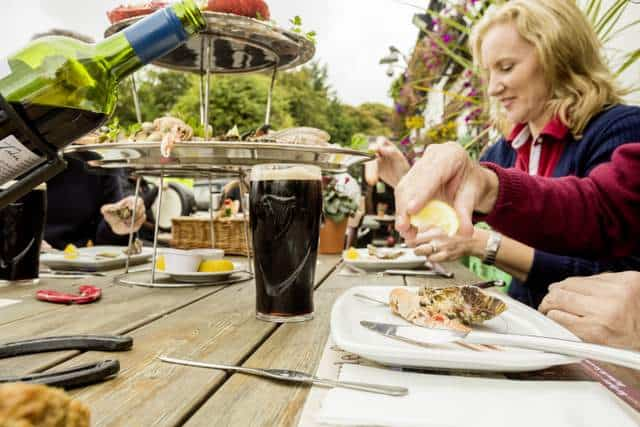 Eating seafood and drinking stout outdoors in Ireland