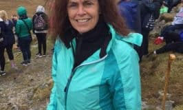 Author Anne Driscoll climbing a mountain in Ireland