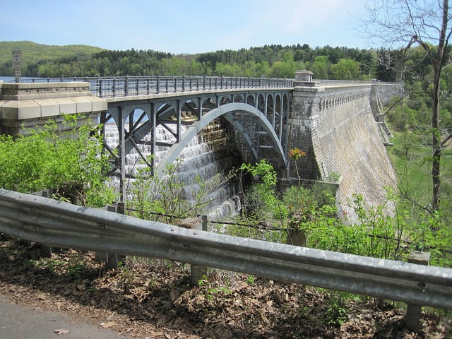 A dam with water cascading down its side