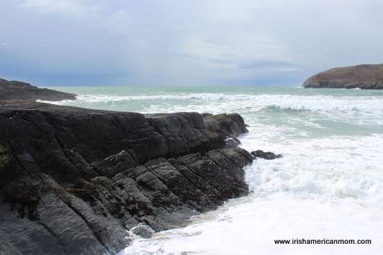Waves crashing on the rocks on a rocky coastline