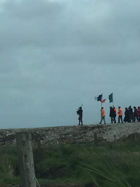 A group of people standing on top of a hill
